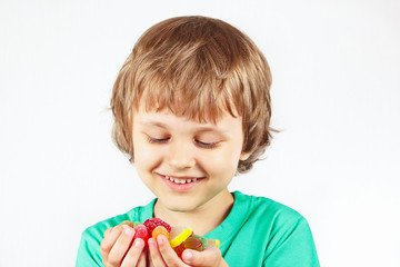 Boy with colored sweets and jelly candies