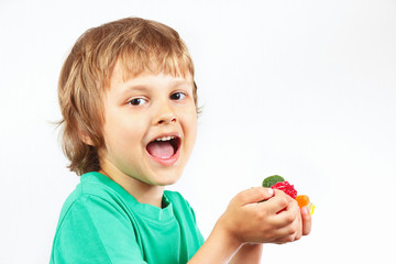 Little boy with colored sweets and jelly candies