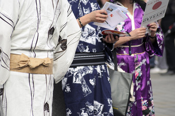 men in kimono with one girl on the right side