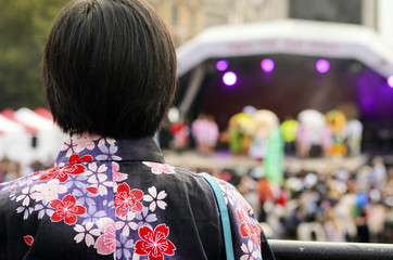 japanese girl is looking at the show
