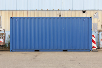 Unmarked blue shipping container.