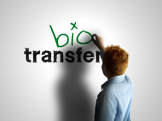 Bio transfer. Boy writing on a white board