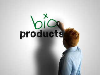Bio products. Boy writing on a white board