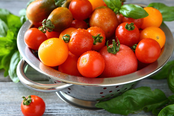 fresh tomatoes in a metal colander