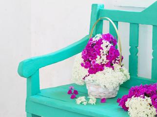 flowers on green wooden bench indoor