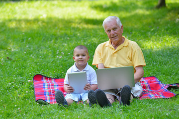 grandfather and child using laptop