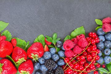 border of fresh berries