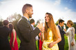 Wedding guests clinking glasses