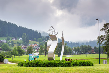 Cyclist monument on the roundabout in Alps, Austria