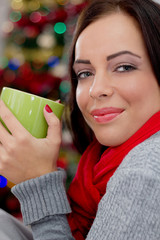 women in Christmas night drinking hot tea