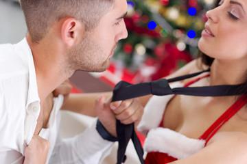 sexy female Santa seduces man on Christmas night