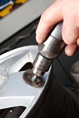 Mechanical repairs a tire.