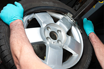 Mechanical repairs a tire.
