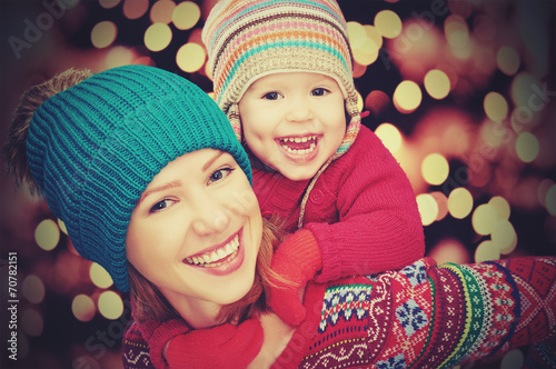 canvas print picture happy family mother and little daughter playing in Christmas