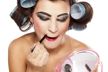 woman with curlers and bad makeup