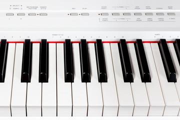 Keys of digital white piano synthesizer