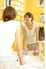 Girl in pajamas brushing her teeth