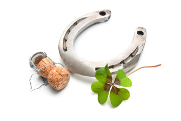 Horseshoe and champagne cork with a four leaf clover