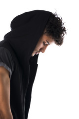 Profile of tough young man in dark hoodie isolated
