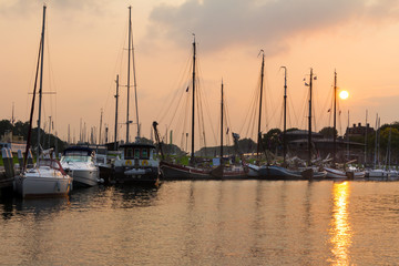 Old Dutch harbor at sunset