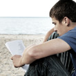 Teenager read outdoor