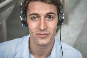 young model hansome blonde manwith headphones