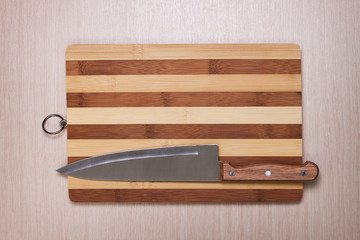 big knife and breadboard on table