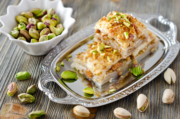 Eastern sweets with pistachios  baklava with green pistachios on