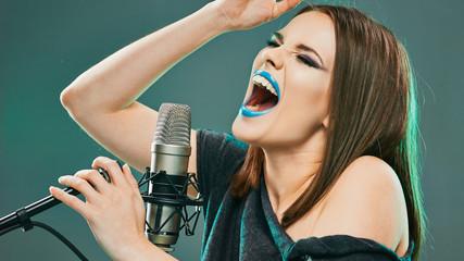 Young woman singer. Karaoke
