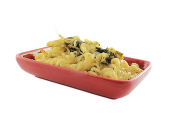 Pasta with spinach in red plate
