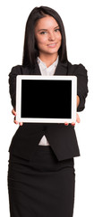Beautiful businesswomen in suit showing tablet pc