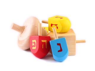 Wooden dreidels for hanukkah isolated on white background.