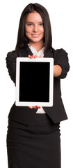 Beautiful businesswoman in suit holds tablet
