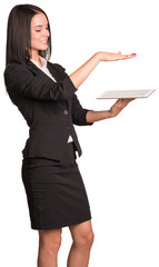 Beautiful businesswoman in suit using tablet