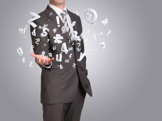 Businessman in suit hold empty hand with flying figures