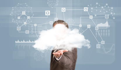 Businessman in suit hold cloud