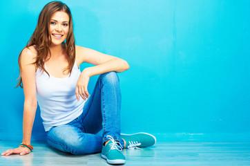 Hipster girl sitting on floor