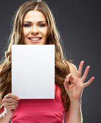 woman holding white blank board show OK symbol