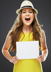 young woman holding white blank card