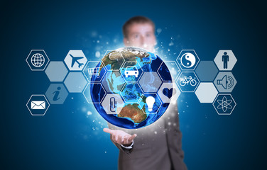 Businessman in suit hold Earth and hexagons with icons