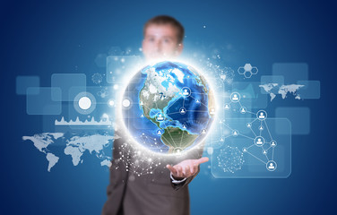 Businessman in suit hold Earth with graphs and network