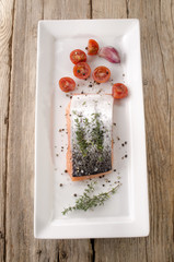 salmon fillet with thyme on a plate