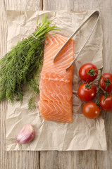 salmon fillet on brown kitchen papper