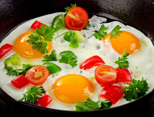 Healthy traditional breakfast with fried eggs and vegetables