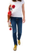 Young woman walking with skateboard