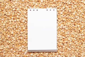blank notebook on dry peas background