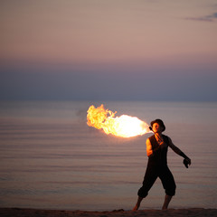 Fire breathing on the beach
