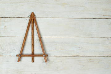 Easel on wooden table