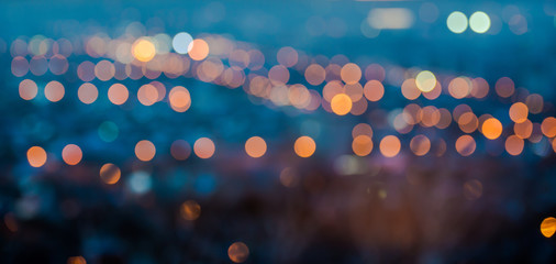 city blurring lights abstract circular bokeh on blue background