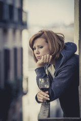 attractive woman suffering depression and stress at home balcony